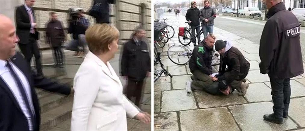 Συνελήφθη διαδηλωτής που επιχείρησε να πλησιάσει την Μέρκελ (βίντεο)