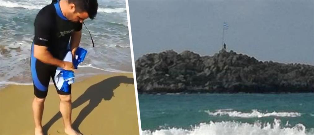 Κολύμπησε μέχρι το νησάκι για να αλλάξει τη φθαρμένη σημαία (βίντεο)