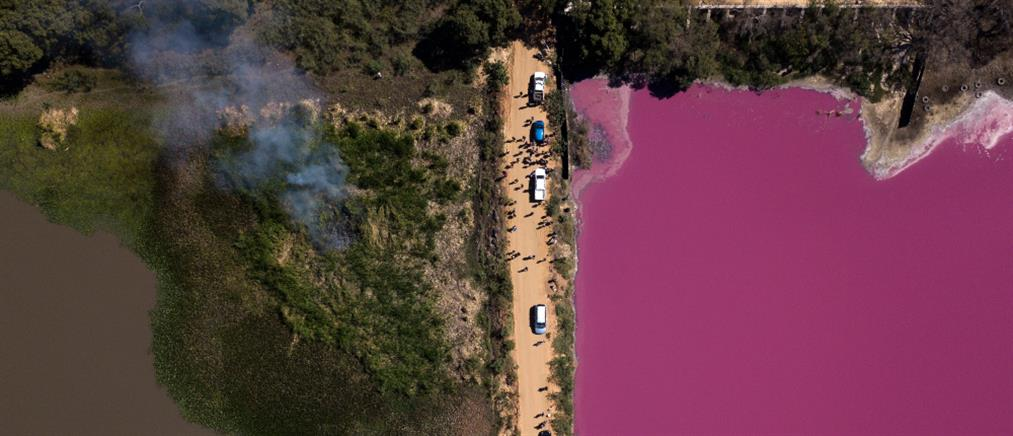 Μόλυνση μετέτρεψε λίμνη φούξια (εικόνες)