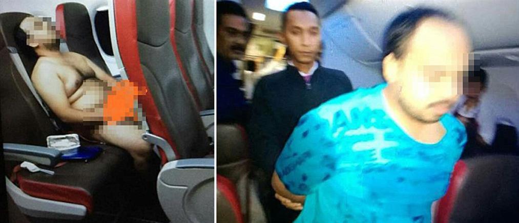 Γδύθηκε και αυνανιζόταν μέσα στο αεροπλάνο! (φωτο)