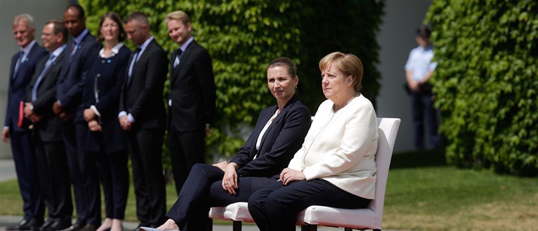 Το τρέμουλο ανάγκασε την Μέρκελ να υποδεχθεί την Δανή Πρωθυπουργό καθιστή (βίντεο)