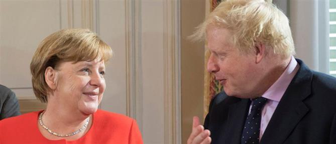 Συμφωνία για το Brexit αναζητούν Τζόνσον και Μέρκελ